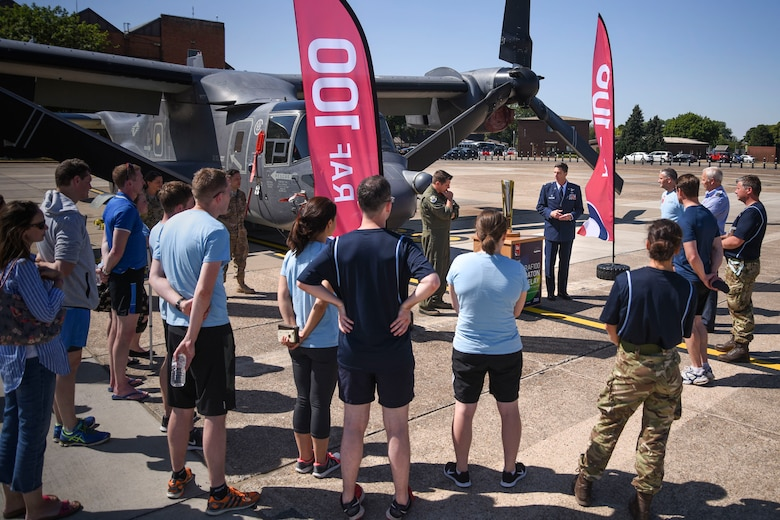 U.S. Air Force Col. Christopher Amrhein, 100th Air Refueling Wing commander, and U.S. Air Force Col. Matthew Smith, 352nd Special Operations Wing commander, thank the Royal Air Force baton relay team for visiting the base and congratulated them on completing their part in the relay at RAF Mildenhall, England, June 29, 2018. Each relay team consists of volunteers, including RAF personnel, cadets, veterans and sporting associations. (U.S. Air Force photo by Senior Airman Christine Groening)