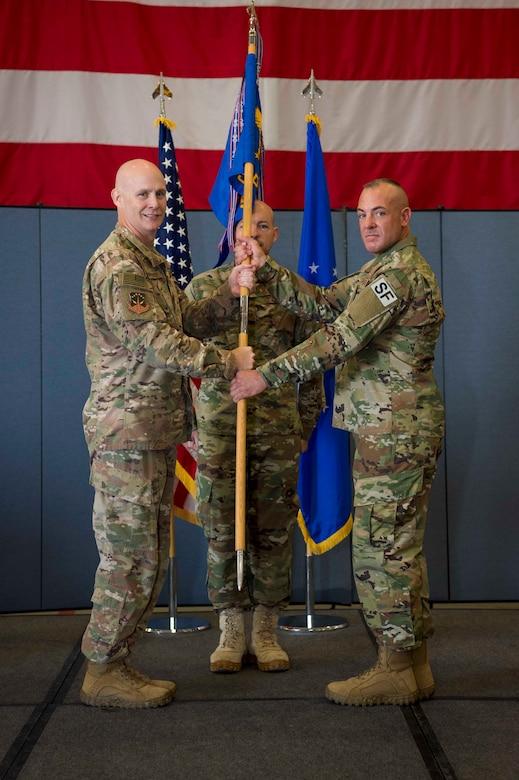 Col. Grimm handing flag to Maj. Hern.