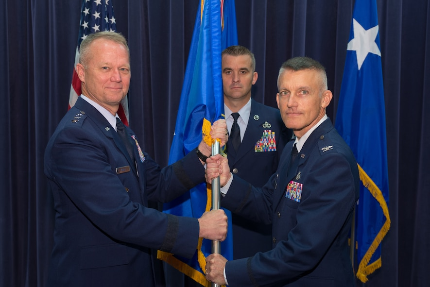 U.S. Air Force Col. Brian Pukall, commander, 557th Weather Wing (WW), assumes command of the 557th WW from U.S. Air Force Lt. Gen. Mark Kelly, commander, 12th Air Force, June 26, 2018, at Offutt Air Force Base, Nebraska. The mission of the 557th WW is to exploit timely, accurate, and relevant weather information anytime and everywhere on the globe. (U.S. Air Force photo by Paul Shirk)