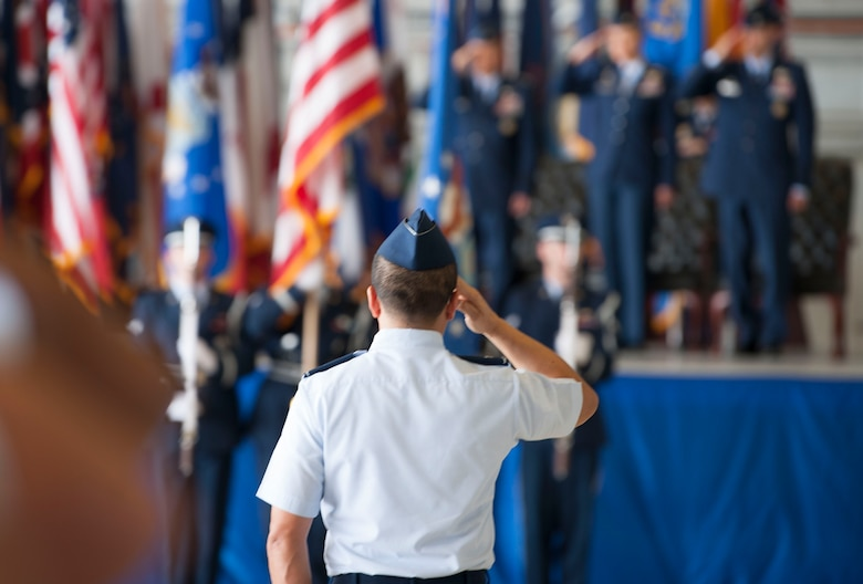 U.S. Air Force Col. Troy Pananon, 6th Air Mobility Wing (AMW) vice commander, renders a salute during the National Anthem at the 6th AMW change of command ceremony, June 29, 2018 at MacDill Air Force Base, Fla.