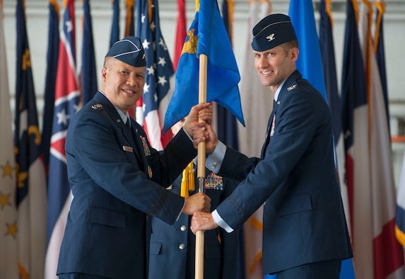 U.S. Air Force Lt. Gen. GI Tuck, commander of the 18th Air Force, passes the 6th Air Mobility Wing guidon to incoming commander, Col. Stephen Snelson, during the wing change of command ceremony at MacDill Air Force Base, Fla., June 29, 2018.