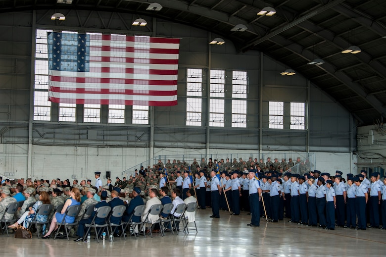 Members of Team MacDill observe the 6th Air Mobility Wing (AMW) change of command ceremony in Hangar 3 at MacDill Air Force Base, Fla., June 29, 2018.