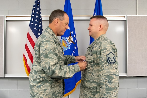 Explosive Ordnance Technician Master Sgt. Joseph Upton recieves his second Purple Heart from Air Force Sustainment Center Commander Lt. Gen. Lee K. Levy II June 22, 2018, at Hill Air Force Base, Utah. Upton was injured in 2013 while supporting an Army unit in Afghanistan. He recieved his first Purple Heart in 2005 while deployed to Iraq. (U.S. Air Force photo by R. Nial Bradshaw)
