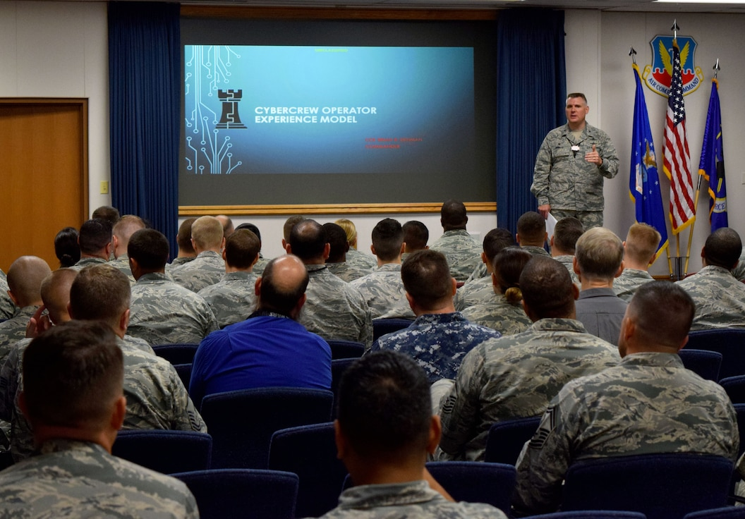 Col. Brian Denman, 567th Cyberspace Operations Group commander, briefs Cyber Protection Team Conference 18-1 attendees at Joint Base San Antonio-Lackland, Texas, June 26, 2018. The three day, 567th COG-hosted conference gathered Total Force and joint cyber professionals to share best practices to improve operational CPT effectiveness. U.S. Cyber Command CPTs defend national and DOD networks and systems against threats, as part of the combatant command's Cyber Mission Force. (U.S. Air Force photo by Tech. Sgt. R.J. Biermann)