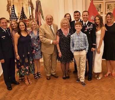 Colonel James A. DeLapp and his family pose for a photo following his retirement dinner June 28, 2016 at the Athelstan Club in Mobile, Al. DeLapp retired after 24 years of service to the U.S. Army Corps of Engineers and the U.S. Army.