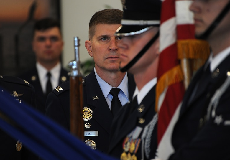 Col. Michael A. Sinks assumes command of the 844th Communications Group during a change-of-command ceremony June 28 on Joint Base Andrews, Maryland.
