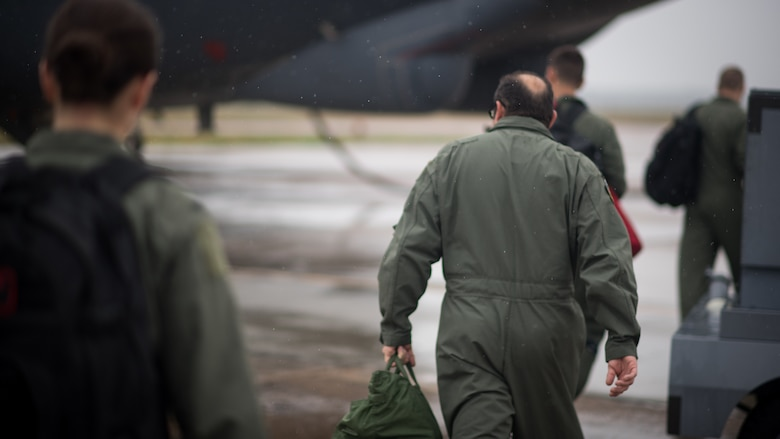 Mike McSwain, 2nd Operations Group honorary commander, walks toward a B-52 Stratofortress with aircrew before an honorary commander's unit orientation flight at Barksdale Air Force Base, La., June 20, 2018. The orientation flight allowed the honorary commander to familiarize himself with the buff while getting to know the aircrew and their tasks during operations.