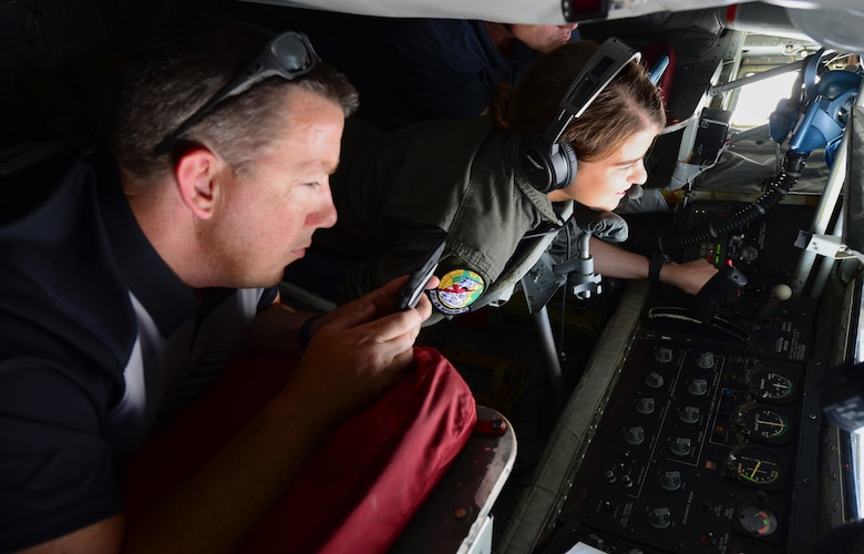 Airman Basic Sarah Cason, a KC-135 boom operator assigned to the 91st Air Refueling Squadron, MacDill Air Force Base, Florida, focuses on the B-52 Stratofortress she's refueling June 27, 2018.