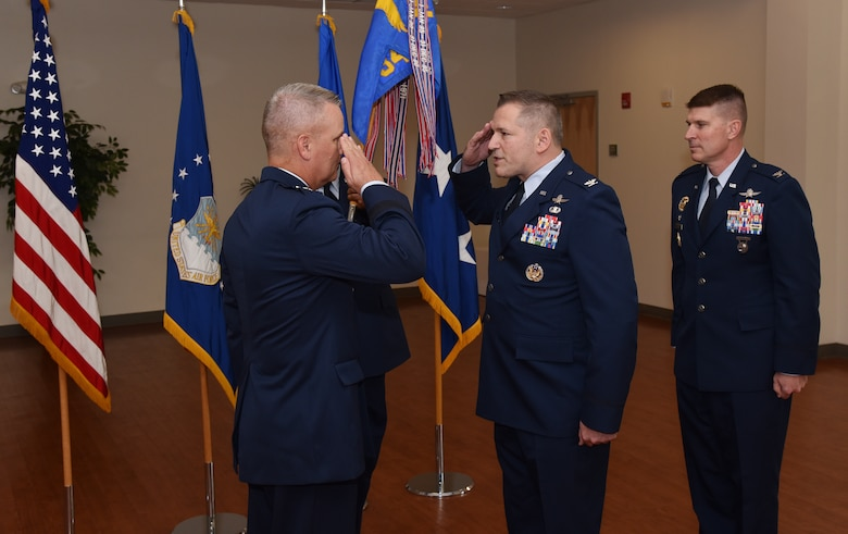 Col. Rocky A. Favorito relinquishes command of the 844th Communications Group to Maj. Gen. James A. Jacobson, Air Force District of Washington commander, during a ceremony June 48 on Joint Base Andrews, Maryland
