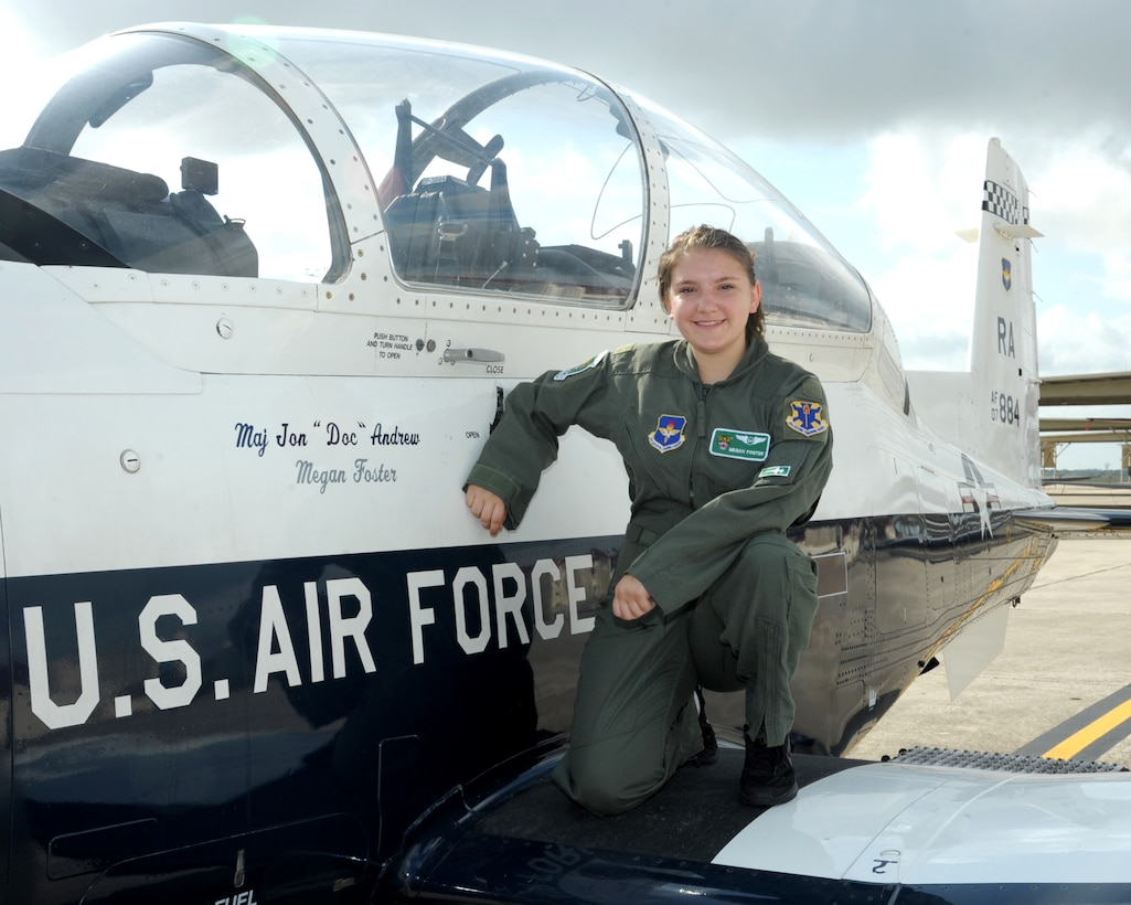 """Megan Foster, sits on the wing of a T-6 Texan II, during her """"Pilot for a Day"""" orientation at June 26, 2018, Joint Base San Antonio-Randolph, Texas.  The """"Pilot for a Day"""" program invites children of all ages, military or civilian, to be guests of the 12th Flying Training Wing and its flying squadrons for an entire day. In so doing, the 12th FTW strives to give each child a special day and a break from the challenges they may face.  (U.S. Air Force photo by Joel Martinez/Released)"""