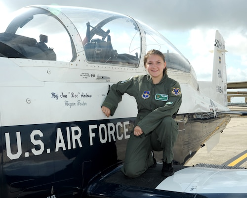 "Megan Foster, sits on the wing of a T-6 Texan II, during her ""Pilot for a Day"" orientation at June 26, 2018, Joint Base San Antonio-Randolph, Texas.  The ""Pilot for a Day"" program invites children of all ages, military or civilian, to be guests of the 12th Flying Training Wing and its flying squadrons for an entire day. In so doing, the 12th FTW strives to give each child a special day and a break from the challenges they may face.  (U.S. Air Force photo by Joel Martinez/Released)"