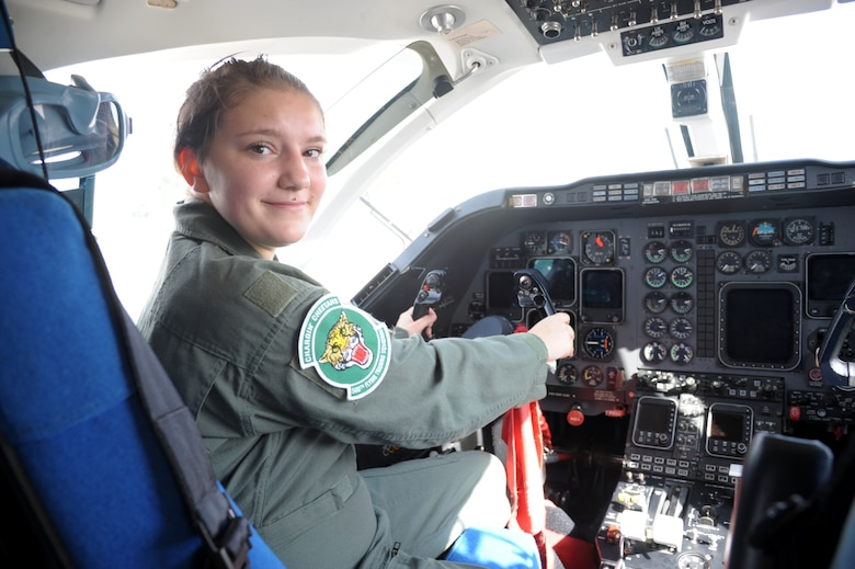 """Megan Foster, sits on the cockpit of a T-1 Jayhawk, during her """"Pilot for a Day"""" orientation at June 26, 2018, Joint Base San Antonio-Randolph, Texas.  The """"Pilot for a Day"""" program invites children of all ages, military or civilian, to be guests of the 12th Flying Training Wing and its flying squadrons for an entire day. In so doing, the 12th FTW strives to give each child a special day and a break from the challenges they may face.  (U.S. Air Force photo by Joel Martinez/Released)"""