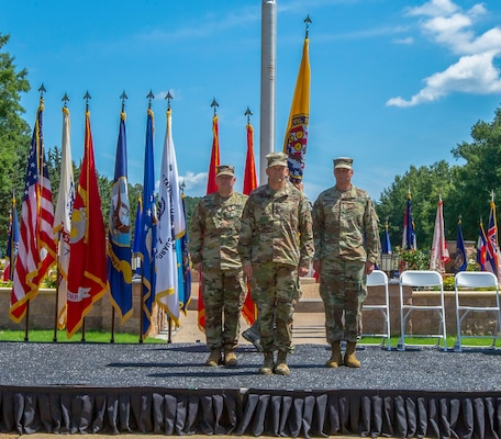 Lt. Gen. Jeffrey Buchanan (center), Maj. Gen. William Hall (left) and Maj. Gen. Richard Gallant (right) participate in the Joint Task Force Civil Support (JTF-CS) Change of Command ceremony on June 29 at Seay Plaza on Fort Eustis. During the ceremony, Hall assumed command of JTF-CS from Gallant and became the tenth commander of JTF-CS. JTF-CS provides command and control for designated Department of Defense specialized response forces to assist local, state, federal and tribal partners in saving lives, preventing further injury and providing critical support to enable community recovery. (Official DoD photo by Mass Communication Specialist 3rd Class Michael Redd/released)