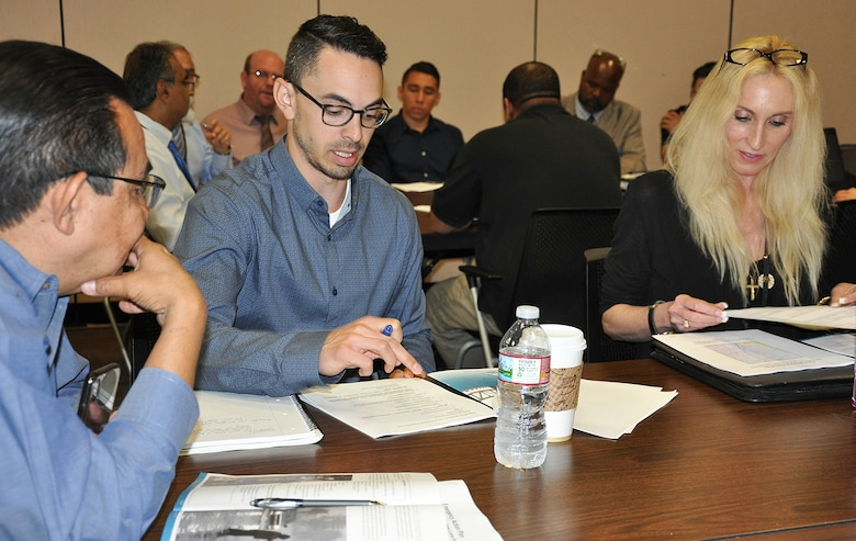 Joe Goldstein, Dam Safety program manager for the U.S. Army Corps of Engineers Los Angeles District, center, works with representatives from Los Angeles County on how the team would respond during a flood-risk tabletop exercise June 21 at the LA County Department of Public Works.