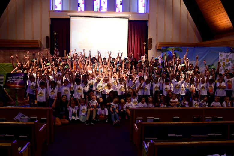 "Vacation Bible School children and volunteers pose for a group photo June 29, 2018 at Fairchild Air Force Base, Washington. With focus on Christian-based beliefs, children spend this five-day youth program in various stations learning different lessons that fit snuggly into the overarching message of ""Rescued by Jesus,"" ultimately building resiliency through religion. (U.S. Air Force photo/Staff Sgt. Nick Daniello)"