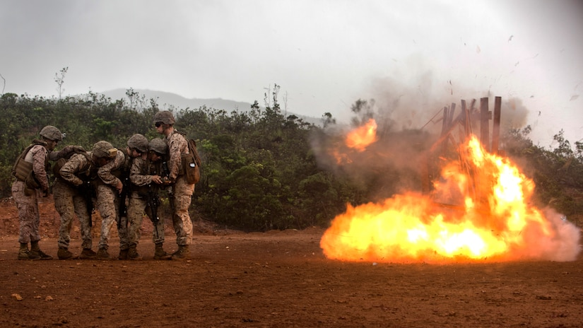 U.S. Marines Corps Combat Engineers with Marine Rotational Force Darwin, conduct a breach at Plum, New Caledonia, May 16, 2018. As a Combat Engineer, performing a breach is an objective that can be tasked if necessary. Their capabilities are both constructive, e.g., building bunkers, providing utilities and destructive, e.g., demolition and breaching support capabilities to the battlefield. This unique combination of capabilities provides knowledge, experience and skills to commanders at the operational and tactical levels with which they can, according to Marine Corps Warfighting Publication 3-34, friction, facilitate maneuver and improve the morale of friendly forces or create friction and disorder for the enemy.