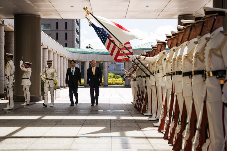Defense Secretary James N. Mattis walks with Japanese Defense Minister Itsunori Onodera in Tokyo.