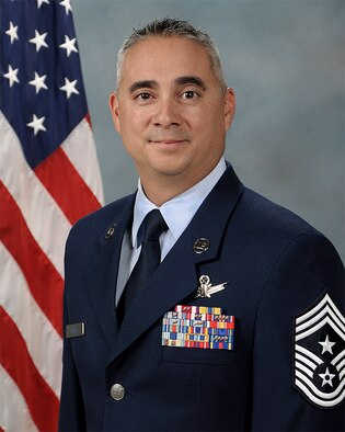 Biography photo for CMSgt Kahn Scalise, 302nd Airlift Wing command chief.