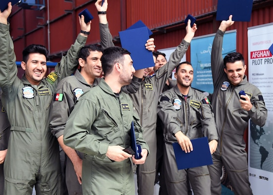 The Afghan Air Force's newest pilots hold up their certificates in celebration after having graduated from Initial Entry Fixed-Wing school at LOM Praha's flight training center, Czech Republic, June 27, 2018. The graduates will return to Afghanistan this week to either continue their training on one of the AAF platforms there, or to prepare to continue training in the U.S.
