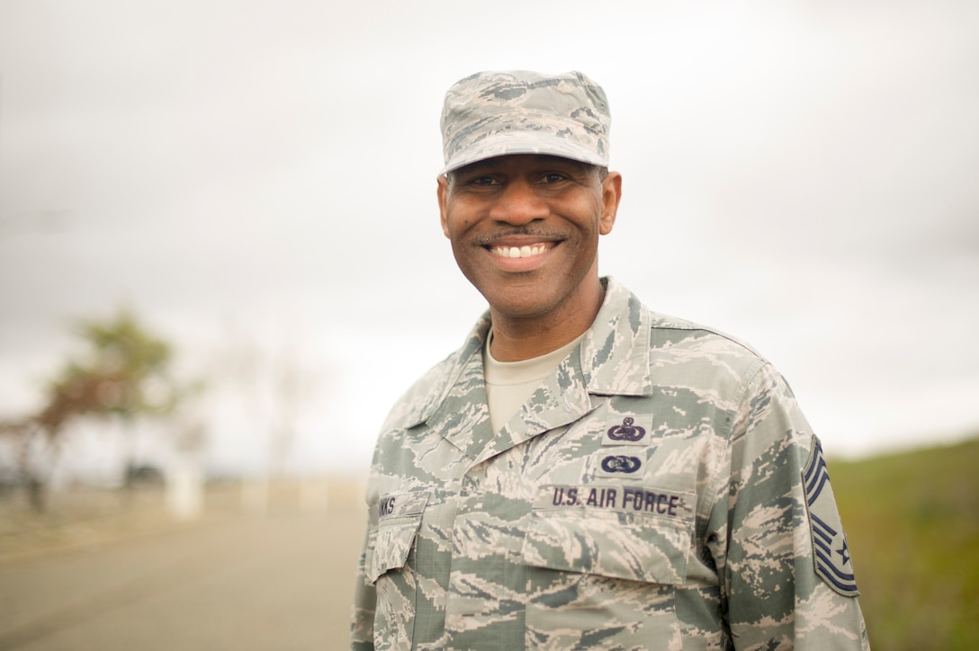 Chief Master Sgt. Martez D. Banks, 940th Operations Group superintendent, stands outside for a photo Feb. 26, at Beale Air Force Base, California.