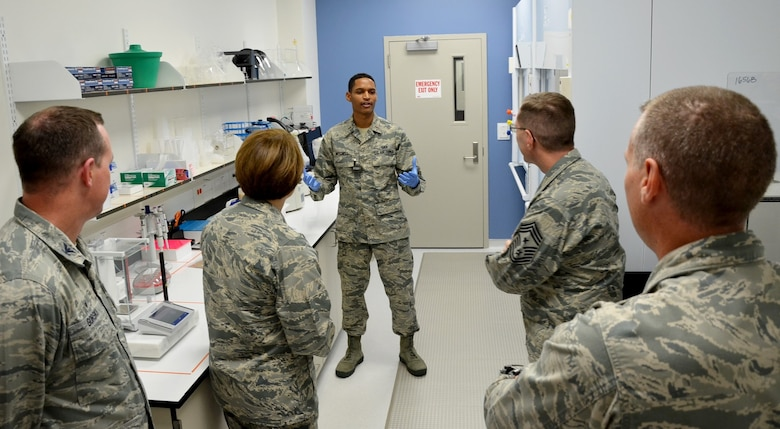 2nd Lt. Kaleb Mitchell (center) a Ciambrone Radiochemistry Laboratory chemist at the Air Force Technical Applications Center, Patrick AFB, Fla., explains to (l. to r.) Col. Steven M. Gorski, AFTAC commander, Maj. Gen. Mary F. O'Brien, 25th Air Force commander, Chief Master Sgt. Stanley Cadell, 25th AF command chief, and Lt. Col. James Thomas, CRL director, how samples undergo radiochemical separation to determine if trace levels of radioactive debris are present in environmental samples.  O'Brien and Cadell toured the facility Feb. 21, 2018.  (U.S. Air Force photo by Susan A. Romano)