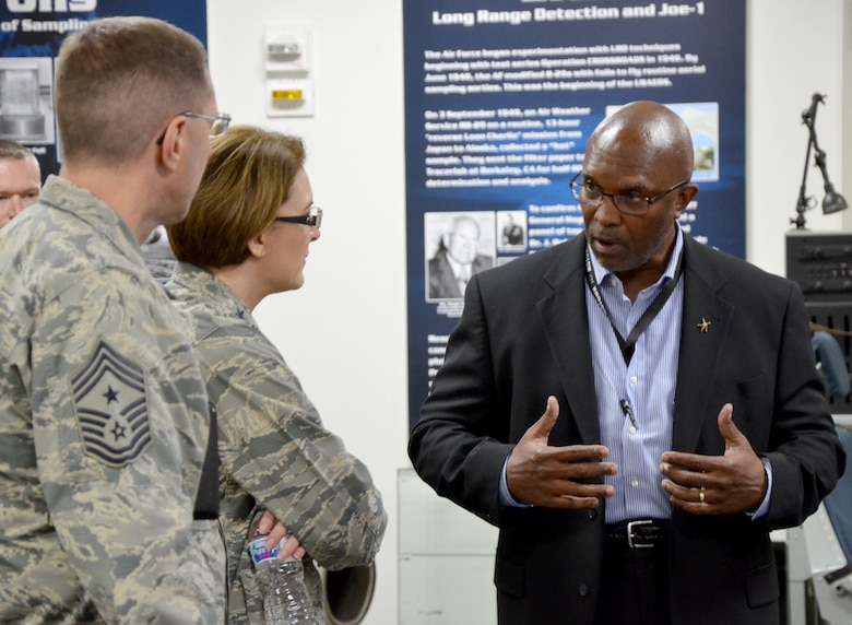 Reggie Crane (right), Workforce Development Program Manager for the Air Force Technical Applications Center, explains to Maj. Gen. Mary F. O'Brien, 25th Air Force commander and Chief Master Sgt. Stanley Cadell, 25th AF command chief, AFTAC's Human Resources strategic approach to developing the workforce, with a focus on enhancing self-awareness and how the center seeks to improve communication effectiveness.  O'Brien and Cadell visited the nuclear treaty monitoring center Feb. 20-21 to meet the Airmen who accomplish their global surveillance mission. (U.S. Air Force photo by Susan A. Romano)