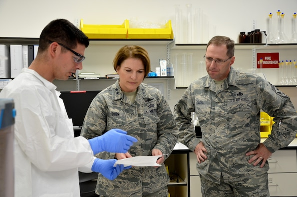 Staff Sgt. Justin A. Baldwin (left) a radiochemistry noncommissioned officer at the Air Force Technical Applications Center, Patrick AFB, Fla., explains to Maj. Gen. Mary F. O'Brien, 25th Air Force commander and Chief Master Sgt. Stanley Cadell, 25th AF command chief, how he prepares reagents and small equipment prior to conducting chemistry operations in the Ciambrone Radiochemistry Laboratory.  O'Brien and Cadell toured the facility Feb. 21, 2018 during a visit to the nuclear treaty monitoring center. (U.S. Air Force photo by Susan A. Romano)