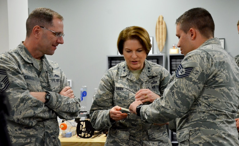 Tech. Sgt. Donald E. Kramer II, noncommissioned officer in charge of Innovation Operations for the Air Force Technical Applications Center, Patrick AFB, Fla., shows Maj. Gen. Mary F. O'Brien, 25th Air Force commander and Chief Master Sgt. Stanley Cadell, 25th AF command chief, one of the projects he's working on at AFTAC's Innovation Lab.  O'Brien and Cadell came from San Antonio, Texas, to Florida to learn more about how the center executes its global nuclear treaty monitoring mission.  (U.S. Air Force photo by Susan A. Romano)