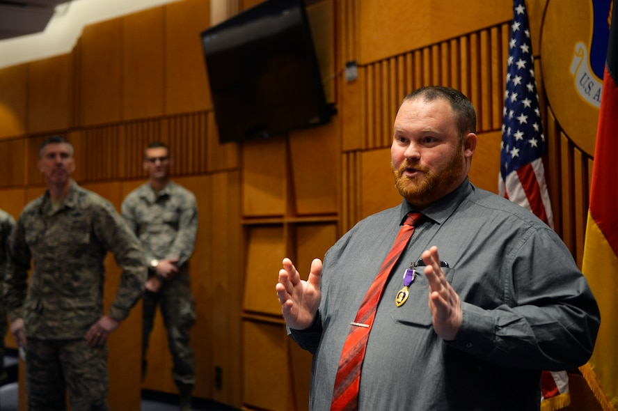 Judson Rackley, U.S. Air Forces in Europe-Air Forces Africa video operations center communications engineer, gives remarks after receiving the Purple Heart on Ramstein Air Base, Germany, Feb. 27, 2018. Rackley received the decoration for wounds he received in combat as a U.S. Army Soldier in Afghanistan in 2010. (U.S. Air Force photo by Senior Airman Joshua Magbanua)