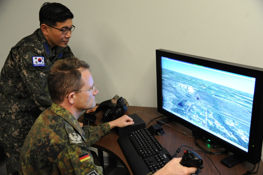 United States Air Force Air War College International Fellows students receive electronically mediated training on the F-35 Lightning II at the F-35 Academic Training Center at Luke Air Force Base, Ariz., Feb. 28, 2018.  The students are part of the AWC Regional and Cultural Studies program. (U.S. Air Force photo/Tech. Sgt. Luther Mitchell Jr.)