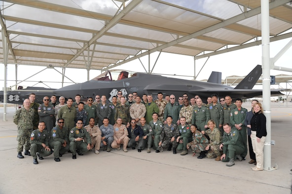 United States Air Force Air War College International Fellows students pose for a group photo in front of an F-35 Lightning II at the 63rd Fighter Squadron at Luke Air Force Base, Ariz., Feb. 28, 2018. The AWC international students received a personal look at how Luke is building the future of Airpower. (U.S. Air Force photo/Tech. Sgt. Luther Mitchell Jr.)
