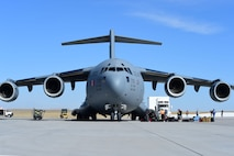 A Boeing C-17 Globemaster III assigned to Travis Air Force Base, California, arrives at Buckley AFB to transport the Interior Exploration using Seismic Investigations, Geodesy and Heat Transport lander Feb. 28, 2018, on Buckley AFB, Colorado. The InSight Transport is a tool that National Aeronautics and Space Administration is using to take measurements of the interior of Mars in order to determine its content. (U.S. Air Force photo by Senior Airman Luke W. Nowakowski)