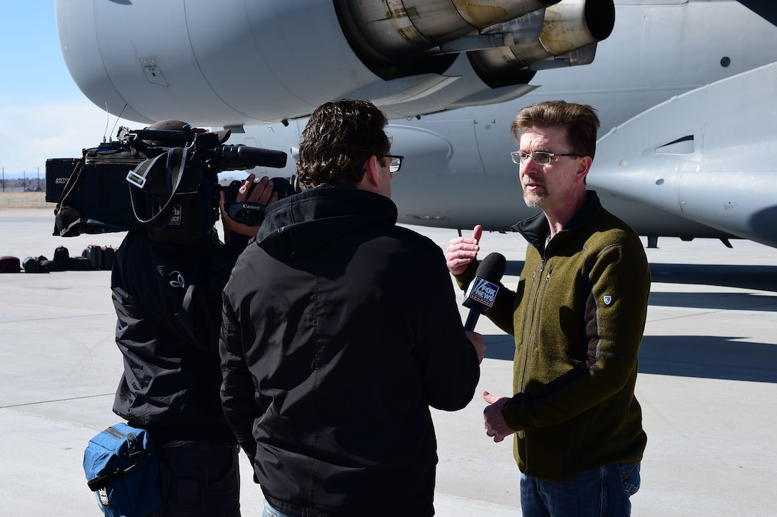 Tim Linn, deputy program manager of entry, decent, and landing at Lockheed Martin, speaks with Fox News about the Interior Exploration using Seismic Investigations, Geodesy and Heat Transport lander that is projected to reach Mars later in the year Feb. 28, 2018, on Buckley Air Force Base, Colorado. The InSight lander uses a 15 foot probe to take measurements of Mars's interior in order to determine its makeup and density. (U.S. Air Force photo by Senior Airman Luke W. Nowakowski)