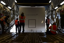 Lockheed Martin employees successfully load the InSight lander onto a C-17 Globemaster III Feb. 28, 2018, on Buckley Air Force Base, Colorado. The lander will be transported to Vandenberg AFB where it will then be launch to Mars using a NASA Atlas 5 rocket. (U.S. Air Force photo by Senior Airman Luke W. Nowakowski)