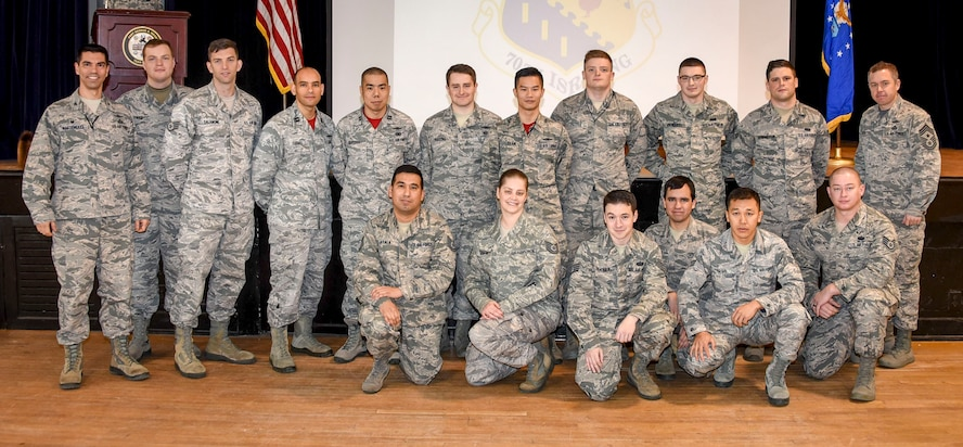 Colonel Matteo Martemucci, 70th Intelligence, Surveillance and Reconnaissance Wing commander, far left and Chief Master Sgt. Chad Houck, 70 ISRW Command Chief, far right, recognize a team of 707th Communications Squadron Airmen during an annual awards ceremony Jan. 19, 2018 at Fort George G. Meade, Md.  On Jan. 2, these Airmen, with help from the 70th ISRW Civil Engineer office, identified a massive leak in one of the buildings which effected network capabilities.  Their quick response and actions led to a quick restoration of network services and saved more than $250,000 in equipment. (U.S. Air Force photo/Staff Sgt. AJ Hyatt)