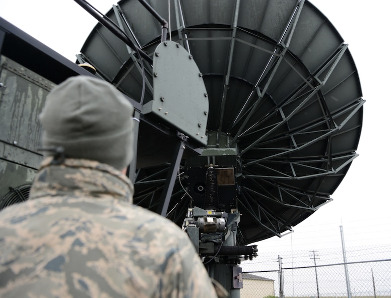 Senior Airman Lauryn Gormaly, 9th Aircraft Communications Maintenance Unit ground communication segment technician, stows an antenna due to inclement weather