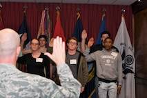 Brig. Gen. Jonathan Ellis from 8th Air Force swears in Navy and Army recruits at the Shreveport MEPS
