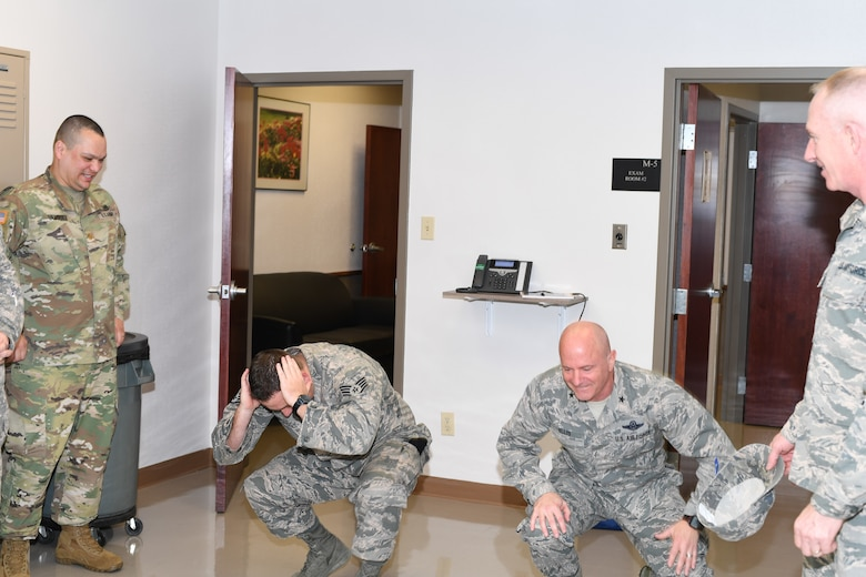"Eighth Air Force members do the ""duck walk"" at the local MEPS"