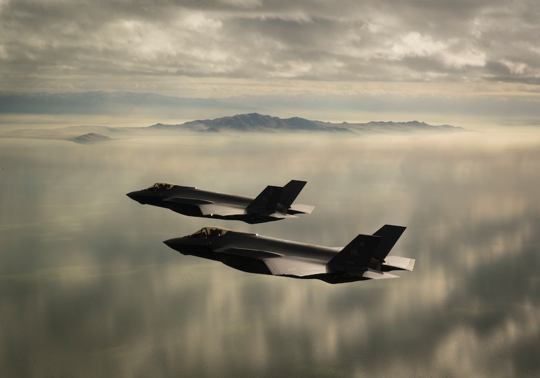 Two F-35A Lightning IIs, assigned to the 4th Fighter Squadron from Hill Air Force Base, Utah, conduct flight training operations over the Utah Test and Training Range on Feb 14, 2018. The F-35A is a single-seat, single engine, fifth generation, multirole fighter that's able to perform ground attack, reconnaissance and air defense missions with stealth capability. (U.S. Air Force photo by Staff Sgt. Andrew Lee)