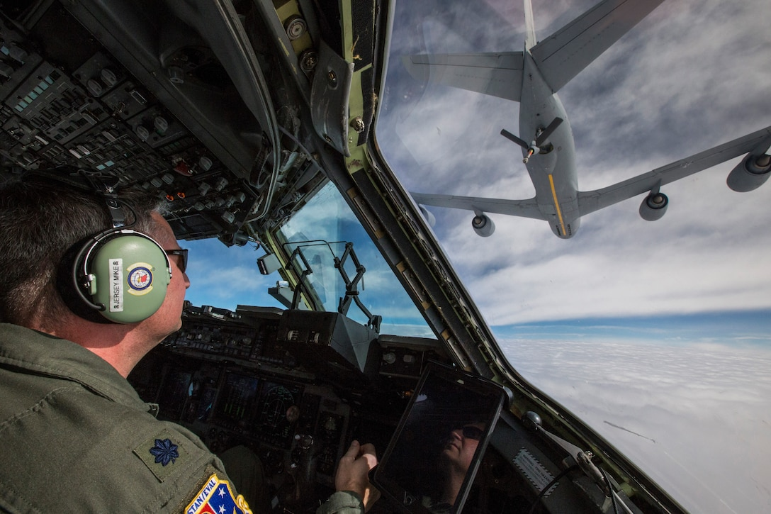 Lt. Col Michael J. Prodeline, a C-17 Globemaster III pilot with the 732nd Airlift Squadron, 514th Air Mobility Wing, maneuvers the C-17 in to be refueled by a KC-135 Stratotanker with the 157th Air Refueling Wing, New Hampshire Air National Guard, over the U.S. Feb. 22, 2018. The 514th AMW is an Air Force Reserve Command unit located at Joint Base McGuire-Dix-Lakehurst, N.J. The 157th ARW is located at Pease Air National Guard Base, N.H. (U.S. Air Force photo by Master Sgt. Mark C. Olsen)