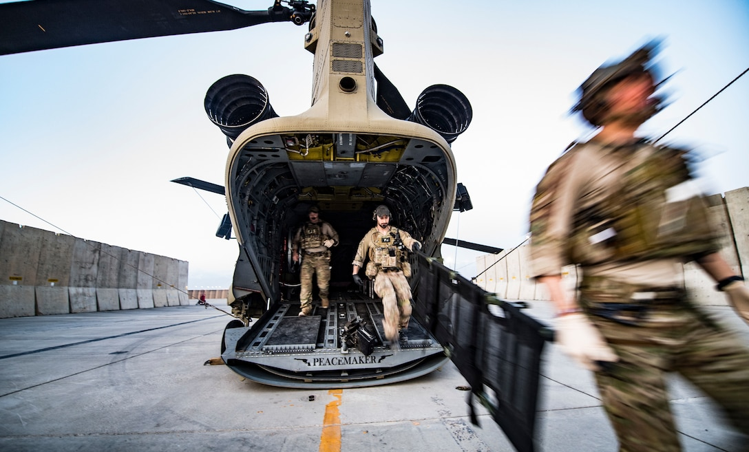Air Force pararescuemen, assigned to the 83rd Expeditionary Rescue Squadron, 455th Air Expeditionary Wing, exit an Army CH-47 Chinook at Bagram Airfield, Afghanistan, Feb. 22, 2018. The pararescuemen primarily fly their missions on Army CH-47F Chinooks, making the 83rd ERQS the first joint personnel recovery team in Air Forces Central Command. (U.S. Air Force Photo by Tech. Sgt. Gregory Brook)