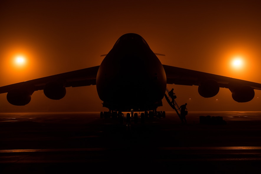 Airmen from the 22nd Airlift Squadron offload from a C-5M Super Galaxy aircraft during a Tuskegee Airmen heritage flight at Killeen-Fort Hood Regional Airport, Texas, Feb. 23, 2018. The flight consisted of an all-black C-5M crew that completed the mission, displayed pride in their heritage and showcased their ability to conduct rapid global mobility in today's Air Force by delivering U.S. Army helicopters to the Central Command area of responsibility. (U.S. Air Force photo by Master Sgt. Joey Swafford)