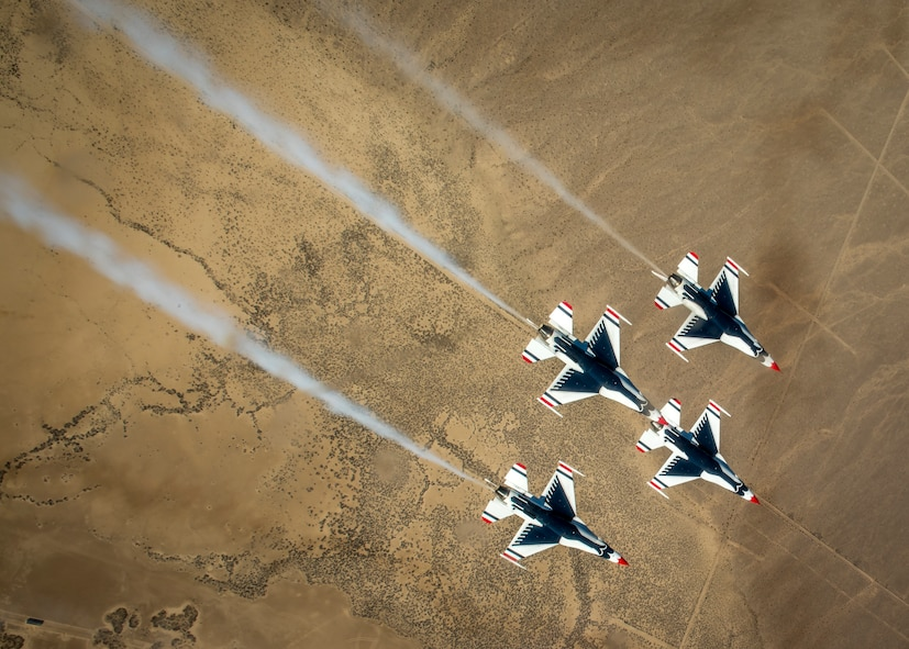 The Thunderbirds Diamond formation pilots perform the Diamond Roll maneuver over the Nevada Test and Training Range during a training flight, Feb. 28, 2018. During the training season, each pilot masters their position and maneuvers, while developing trust within the formation. (U.S. Air Force photo by Staff Sgt. Ned T. Johnston)