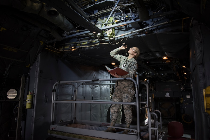 Airman 1st Class Britainy Schmid, 364th Training Squadron hydraulic apprentice course student, inspects a booster pack for damage on a C-130 Hercules at Sheppard Air Force Base, Texas, Feb. 13, 2018. The booster pack powers the ailerons on the aircraft. Schmid is in block four of eight and scheduled to graduate March 21. (U.S. Air Force photo by Alan R. Quevy)