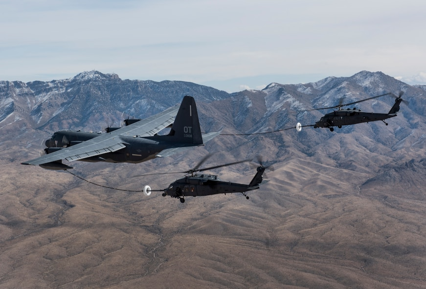 A pair of HH-60 Pave Hawk helicopters receive fuel from a HC-130J Combat King II during a training mission over the Nevada Test and Training Range Feb. 22, 2018. The HC-130J is designed to conduct personnel recovery missions, provide a command and control platform, in-flight refuel helicopters, and carry supplemental fuel for extending range or air refueling. (U.S. Air Force photo by Senior Airman Kevin Tanenbaum)