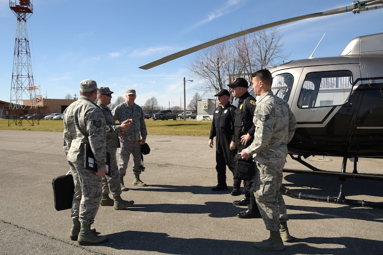 Nearly 10 Airmen with the 178th Wing team up with the Ohio State Highway Patrol Aviation Department to provide flood relief assistance for several counties in the tri-state area, Ohio, Feb. 27, 2018. The birds-eye view imagery provided detailed information for emergency agencies to effectively provide relief to the damaged areas. The 178th Airmen were able to leverage their technological skills with the Ohio State Patrolmen's knowledge of the layout of the land to get help to Ohioans where it is needed most. (U.S. Air National Guard photo cleared for public release)