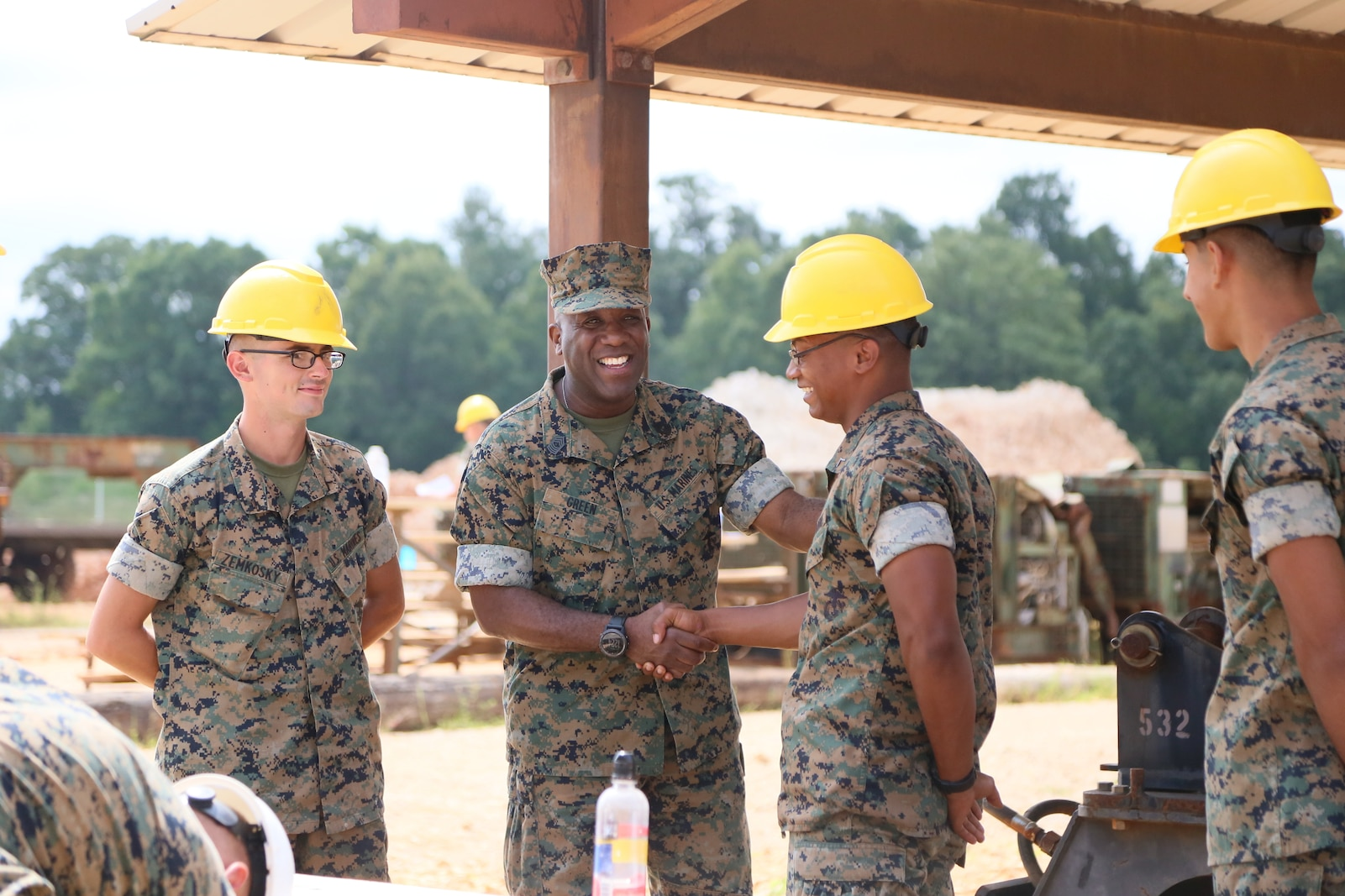 Sergeant Major of the Marine Corps Ronald L. Green greets students on Fort Leonard Wood, MO August 28th, 2017 at Engineer Equipment Instruction Company's training area. The student's state of well-being and continuing to learn their Military Occupational Specialty are the core for the Marine Corps future success. (U.S. Marine Corps photo by Sgt. Teng Yang)