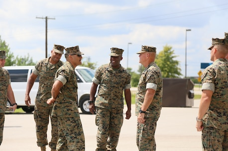 MSgt James J. Fuentes the Military Police Course Chief gives the Commandant of the Marine Corps a tour of one of the Military Police training areas on Fort Leonard Wood, MO August 28th, 2017. As the Military Police Course Chief, MSgt Fuentes is responsible for the day to day operations, he is in charge of 300 entry level students and 32 Military Police Instructors. (U.S. Marine Corps photo by Sgt. Teng Yang)