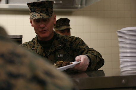 Chief Warrant Officer 5 Steven F. Spark, Chemical Biological Radiological Nuclear Company Commander, also assist in serving meals for the Marine Corps Detachment Fort Leonard Wood Student population. (U.S. Marine Corps photo by Sgt. Teng Yang)