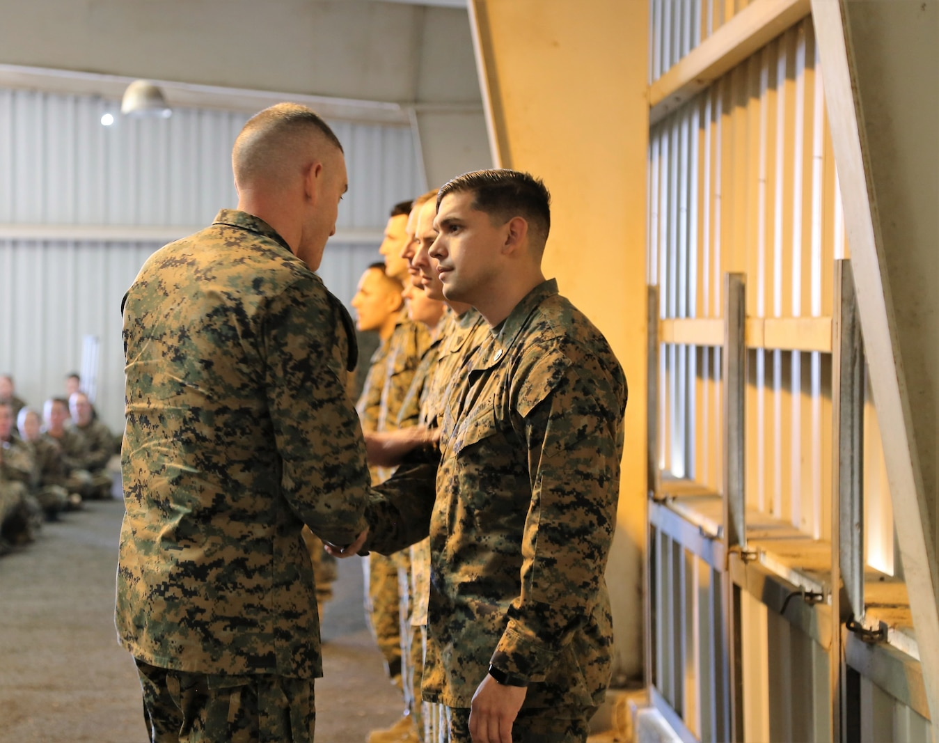 SSgt Joseph T. Dickenson the first Marine to receive a coin from Brigadier General Jason Q. Bohm Commanding General, Training Command at Fort Leonard Wood, MO Jan. 24th, 2018. SSgt Dickenson is in charge of the Leadership Professional Development Training program which was only put in effect less than a year and has been successful with his leadership, the command takes time to recognize him for his outstanding effort.  (U.S. Marine Corps photo by Sgt. Teng Yang)